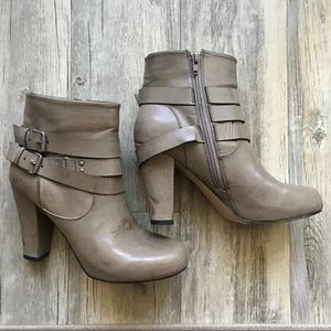 Tan ankle booties with silver clasp detail